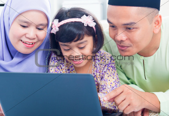 Asian family browsing internet