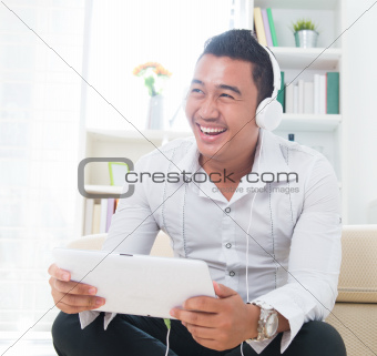 Asian man listen music with headphone