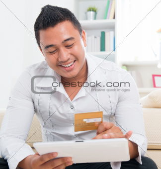 Asian man online shopping