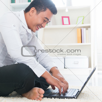 Asian man surfing internet