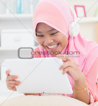 Asian teenager listen mp3 headphone