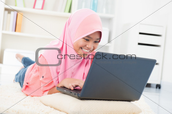Asian teenager surfing internet