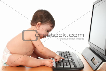Baby typing enter on a computer keyboard