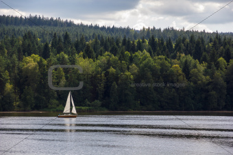 Sailboat on lake.