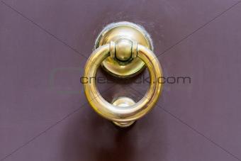 old brass ring door handle