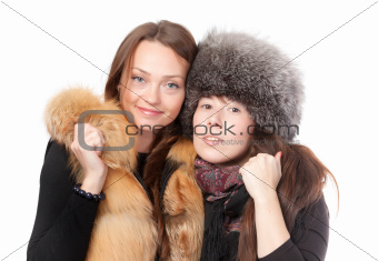 Two attractive women dressed for winter
