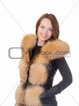 Stylish woman in winter fur jacket