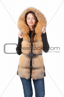 Beautiful woman in fur trimmed jacket