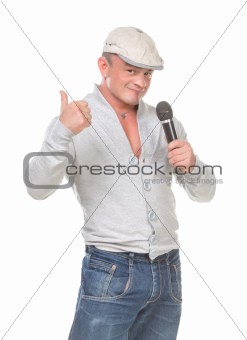 Man in a Cap with a Microphone shows Thumb-up