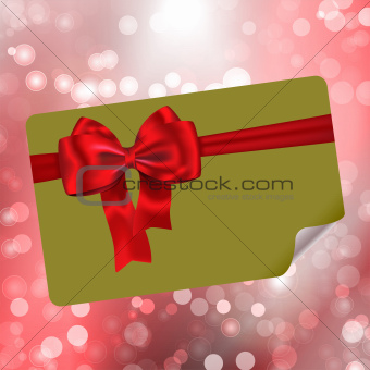 Paper with bow on bokeh lights abstract background