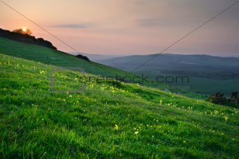 Sunset over lush green countrysidel landscape
