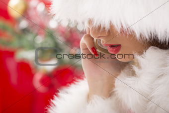 Gorgeous Santa girl speaking at phone.