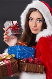 Santa girl with present boxes