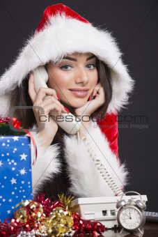 Smiling Santa girl on the phone