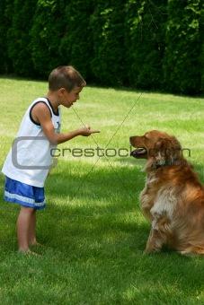 Boy Instructing Dog