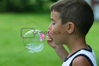 Boy Blowing a Bubble