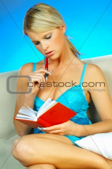 Blonde woman with datebook
