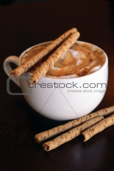 Cappucino with chocolate sticks