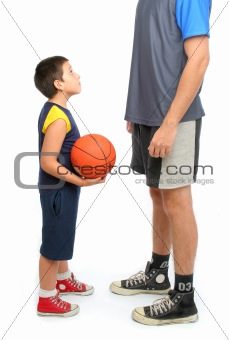 little boy asking big man to play basketball