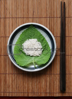 Rice on a green leaf - healthy eating