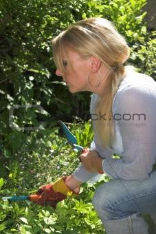 Blond woman working in the garden