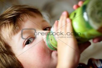 Boy drinks juice