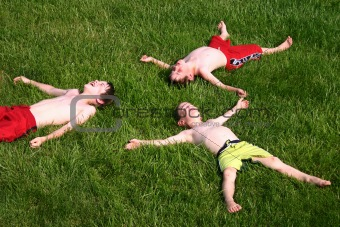 3 Boys Laying in the Sun
