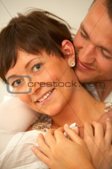 A young couple embracing