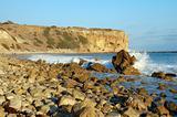 Rocky Beach with waves  splashing Water