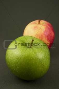 A green and a red apple