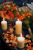 Candles and Flower Petals on table