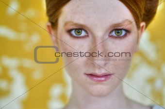 red head, green eyes and yellow wall