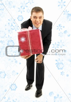 businessman with pink gift package and snowflakes
