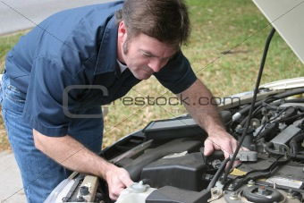 Auto Mechanic Checks Engine