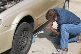 Mechanic Using Jack