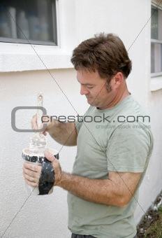 Painter Dipping Brush