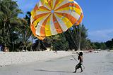 paragliding on sand beach