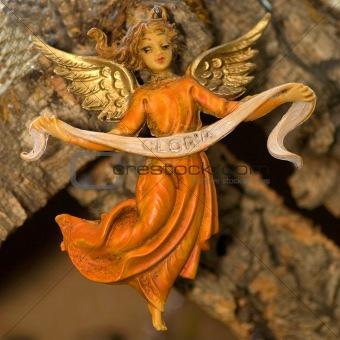 Angel holding Gloria Banner