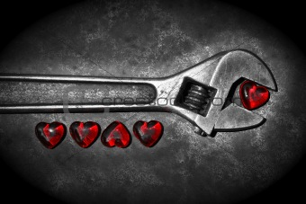 Five grunge hearts with wrench