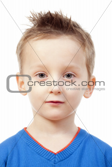 portrait of a boy with brown hair in blue top - isolated on white