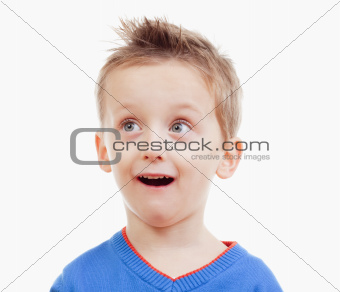 portrait of a boy with brown hair in blue top looking- isolated on white