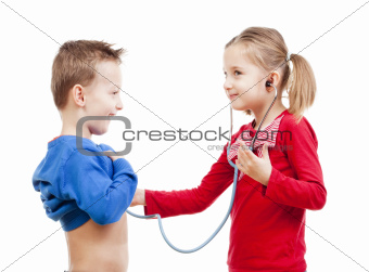brother and sister playing a doctor with stethoscope - isolated on white