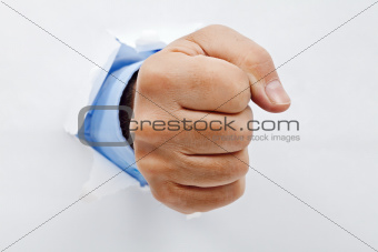 Businessman fist through the paper