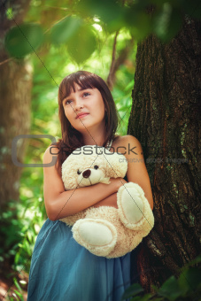 Girl staying near the tree