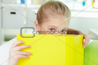 Peeking out of book