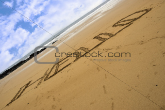 Hello inscribed on a sandy beach