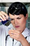 Research scientist testing specimen in laboratory