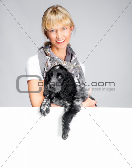dog and smiling woman with white banner
