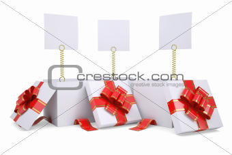 Open gift boxes with white labels
