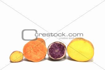 Potatoes (Solanum tuberosum) and a sweet potato (Ipomoea batatas)
